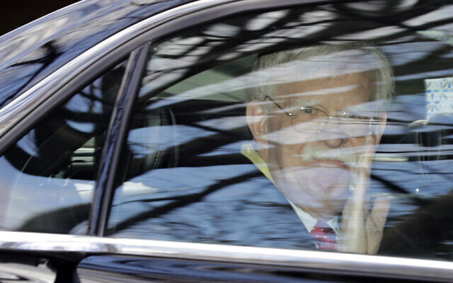Former National security adviser John Bolton waves as he leaves his home in Bethesda, Maryland, January 28, 2020. (Luis M. Alvarez/AP)