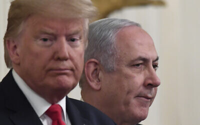 US President Donald Trump, left, and Prime Minister Benjamin Netanyahu during an event in the East Room of the White House in Washington, January 28, 2020, to announce the Trump administration's plan to resolve the Israeli-Palestinian conflict. (AP Photo/Susan Walsh)