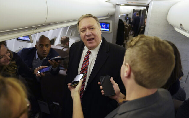 US Secretary of State Mike Pompeo speaks to reporters aboard his plane en route to London, Wednesday Jan. 29, 2020.(Kevin Lamarque/Pool via AP)