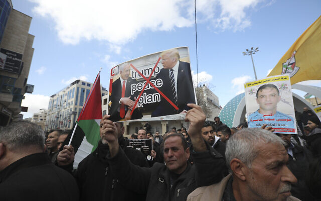 Palestinians protest the Mideast plan announced by US President Donald Trump, in Hebron, West Bank, January 30, 2020. (Mahmoud Illean/AP)