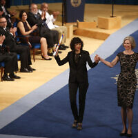 FILE -- Emmanuelle Charpentier of France, left and Jennifer Doudna of the US are applauded by other prize winners after receiving the Princess of Asturias Technical and Scientific Research award from Spain's King Felipe VI at a ceremony in Oviedo, northern Spain, Oct. 23, 2015.  (AP Photo/Jose Vicente)