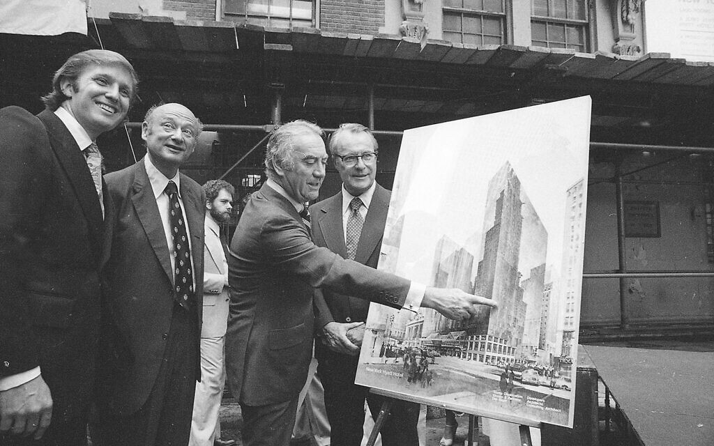 Governor Hugh Carey points to plans for a New York Hyatt Hotel/Convention facility, June 28, 1978.  At the launching ceremony are, from left:  Donald Trump, son of the city developer Fred C. Trump; Mayor Ed Koch of New York; Carey; and Robert T. Dormer, executive vice president of the Urban Development Corp.  (AP Photo)
