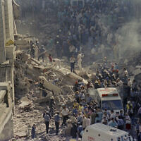 Firemen and rescue workers walk through the debris after a terrorist attack on Israel's embassy in Buenos Aires, Argentina, March 17, 1992. (Don Rypka/AP)