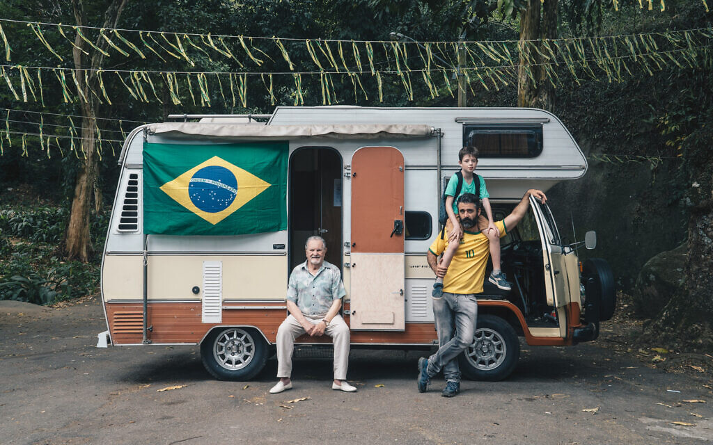 In this still from the 2018 film 'Back to Maracana,' three generations of the fictional Spivak family are shown beside the mobile home they use on a trek through Brazil during the 2014 World Cup. (Courtesy)