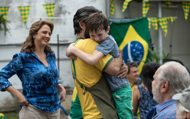 In this still from the 2018 film 'Back to Maracana,' some long overdue bonding takes place between Brazilian-Israeli father Roberto (Asaf Goldstien) and his son Itai (Rom Barnea). (Courtesy)