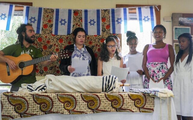 The Be'chol Lashon organization promotes ethnic diversity within the Jewish community, including holding a summer camp for Jewish kids from diverse backgrounds, like this group celebrating Shabbat in 2016. (Courtesy Be'chol Lashon)