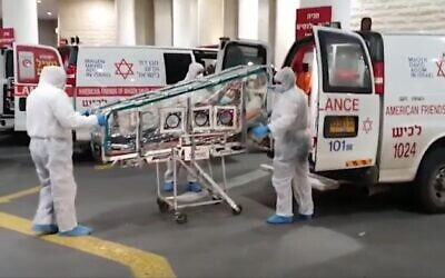 Screen capture from video of a Chinese laborer, suspected of suffering from the cornoavirus, being brought to Barzilai Medical Center, January 2020. (Ynet news)