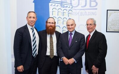 Now-executive director of the Community Security Initiative Mitchell Silber, left, meets with Jewish community leaders in Brussels, Belgium, in 2018. (Courtesy)