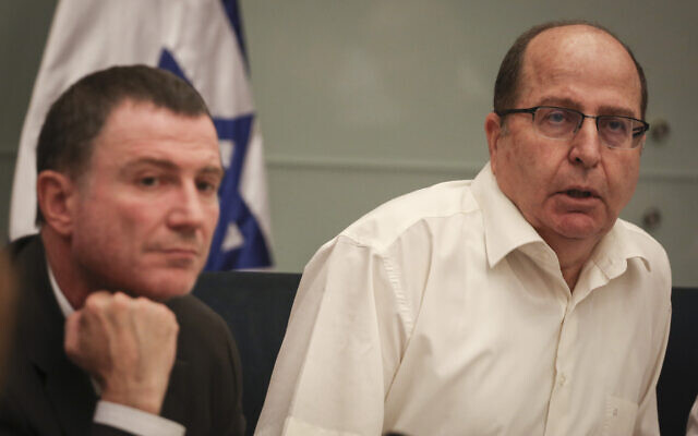 Then Defense Minister Moshe Ya'alon (R) and Knesset Speaker Yuli Edelstein speaks during a Knesset Foreign Affairs and Defense Committee meeting on July 13, 2015. (Hadas Parush/Flash90)