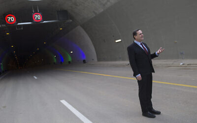 Then-Transportation Minister Yisrael Katz poses for a picture during a ceremony opening the new Harel tunnels on highway 1, the Tel Aviv-Jerusalem Road, on January 19, 2017. (Yonatan Sindel/Flash90)