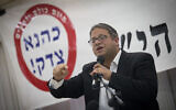 """Itamar Ben Gvir of the Otzma Yehudit party speaks during a ceremony in Jerusalem marking the 27th anniversary of the killing of extremist rabbi Meir Kahane, November 7, 2017. The sign behind him reads, """"Kahane was right!"""" (Yonatan Sindel/Flash90)"""