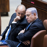 Prime Minister Benjamin Netanyahu (R) speaks with then educationminister Naftali Bennett during a Knesset plenum session on November 13, 2017. (Yonatan Sindel/Flash90)