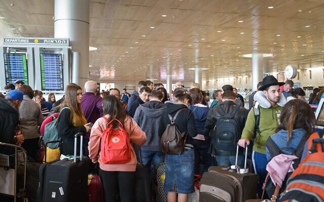 Illustrative: Passengers wait at the departure terminal at Ben Gurion International airport on December 17, 2017. (Avi Dishi/Flash90)