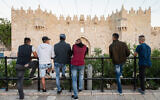 Illustrative: Palestinians standing outside Damascus Gate in the Old City, East Jerusalem on May 14, 2018. (Dario Sanchez/Flash90)
