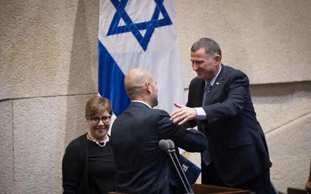 Knesset Speaker Yuli Edelstein (R) embraces Amir Ohana after the latter's appointment as justice minister, at the Knesset in Jerusalem on June 12, 2019. (Yonatan Sindel/Flash90)