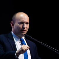 Defense Minister Naftali Bennett speaks at a conference organized by the Makor Rishon newspaper at the International Convention Center in Jerusalem, December 8, 2019. (Yonatan Sindel/Flash90)
