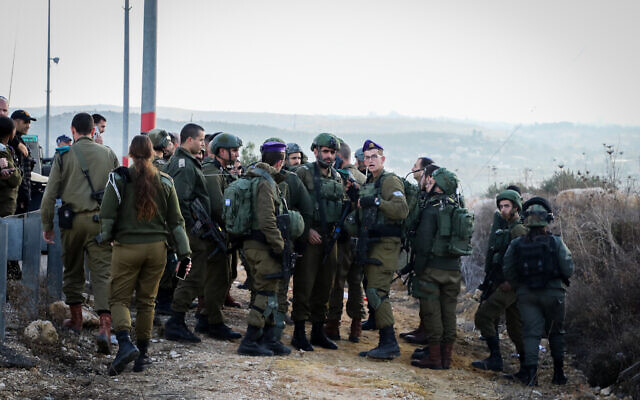 Israeli security forces and medical personnel at the scene of an attempted stabbing attack at the Gush Etzion Junction on January 2, 2020. (Gershon Elinson/Flash90)