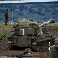 Illustrative: IDF troops near the Israel-Syria border, in the Golan Heights on January 3, 2020. (Basel Awidat/Flash90)