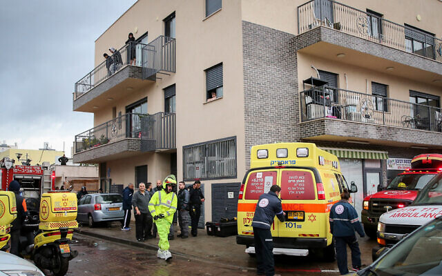 Rescue teams and security forces at the scene where a man and a woman drowned after they were trapped in an elevator that became engulfed by floodwaters in Tel Aviv on January 4, 2020. (Flash90)