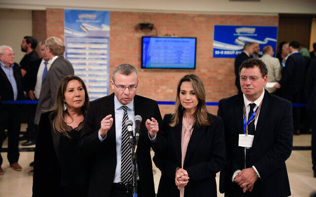 Likud party members speak to press at the entrance to the Central Elections Committee in the Knesset, January 15, 2020. (Olivier Fitoussi/Flash90)