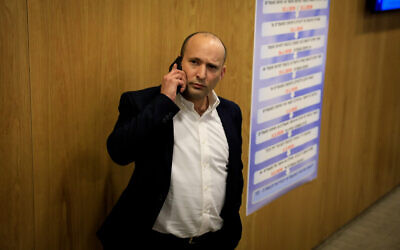 Defense Minister Naftali Bennett arrives at the Knesset to file the national-religious Yamina alliance's list of candidates for the upcoming elections, January 15, 2020. (Olivier Fitoussi/Flash90 )