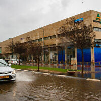 A flooded road after heavy rainfall in the central city of Netanya, on January 19, 2020. (Flash90)