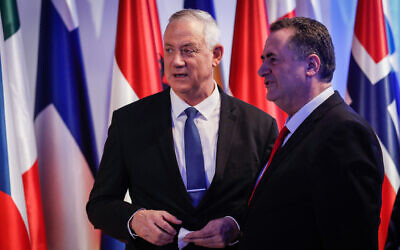 Blue and White leader Benny Gantz, left, with Likud party member and Foreign Minister Israel Katz at the President's Residence in Jerusalem as President Reuven Rivlin hosts over 40 world leaders as part of the World Holocaust Forum, on January 22, 2020. (Olivier Fitoussi/Flash90)