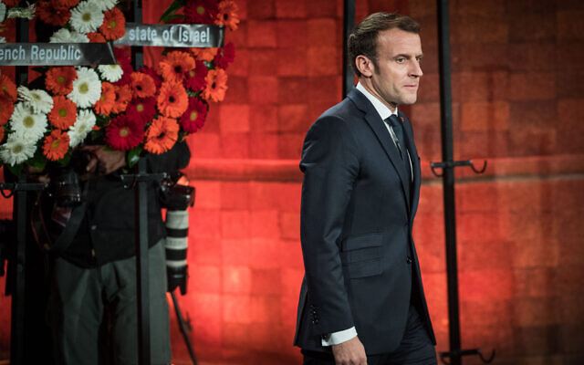 French Republic President Emmanuel Macron at a wreath laying ceremony during the Fifth World Holocaust Forum at the Yad Vashem Holocaust memorial museum in Jerusalem on January 23, 2020. (Yonatan Sindel/Flash90)