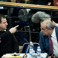 Leader of the Joint List Ayman Odeh (L) with fellow faction member Ahmad Tibi during the Central Elections Committee discussion of requests to disqualify Joint List party candidate Heba Yazbak from running in the upcoming Knesset Elections on January 29, 2020. (Yonatan Sindel/Flash90)