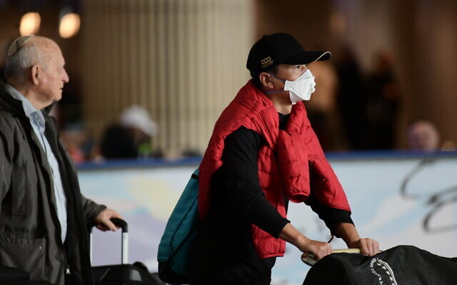 A man wearing a face mask at the arrivals hall of Ben Gurion Airport on January 30, 2020. (Tomer Neuberg/Flash90)