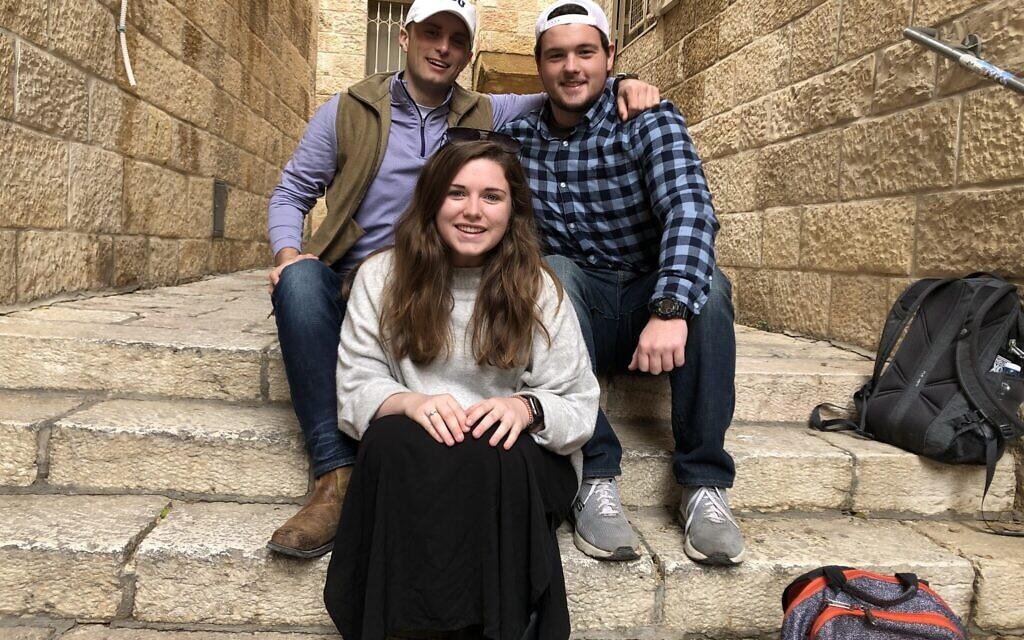 Left to right: Cage Sawyers, Kate Mullen, and Seth Bray take a break in Jerusalem's Old City on a Passages trip, January 5, 2020. (Renee Ghert-Zand/TOI)