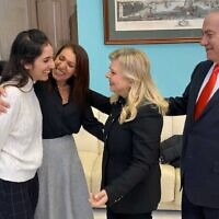 Naama Isaachar (left) is greeted by Sara Netanyahu while her mother Yaffa (second left) and Prime Minister Benjamin Netanayhu look on at the Moscow airport, January 30, 2020 (GPO)
