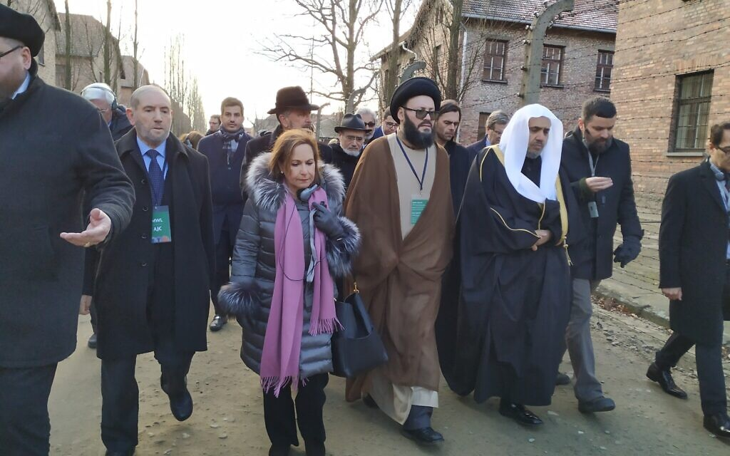 Interfaith delegation to Auschwitz including Muslim World League head Mohammed al-Issa, center-right with white head covering, January 23, 2020. (Yaakov Schwartz/ Times of Israel)