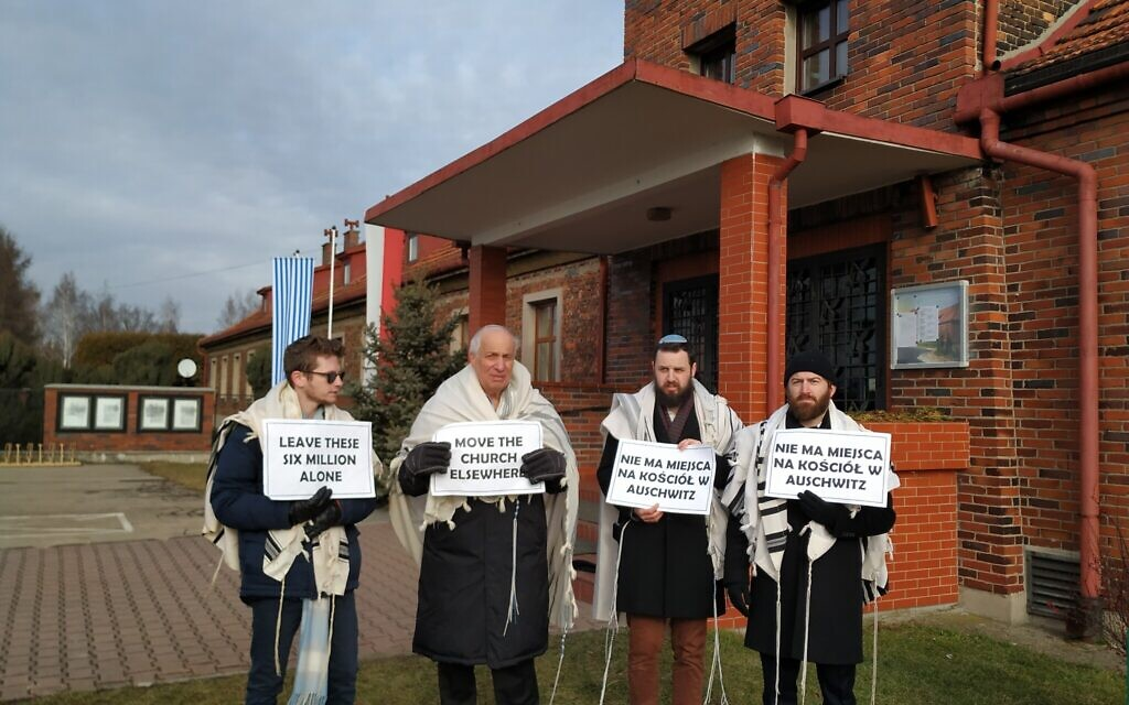 From left to right, rabbis Shabbos Kestenbaum, Avi Weiss, Ezra Seligsohn, and Jonathan Leener protest the location of a church in a former SS headquarters across from the former Nazi death camp Birkenau, January 27, 2020. (Yaakov Schwartz/ Times of Israel)