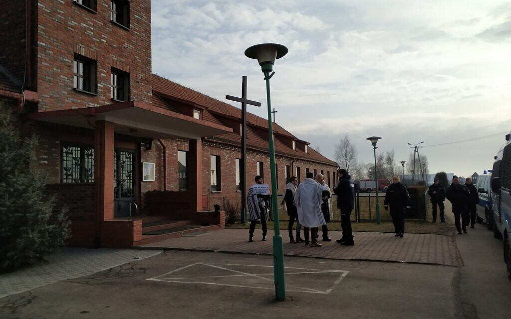 Rabbis Shabbos Kestenbaum, Avi Weiss, Ezra Seligsohn, and Jonathan Leener protest the location of a church in a former SS headquarters across from the former Nazi death camp Birkenau, January 27, 2020. (Yaakov Schwartz/ Times of Israel)