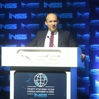 Defense Minister Naftali Bennett speaks at the Institute for National Security Studies think tank's annual conference in Tel Aviv on January 29, 2020. (Ariel Hermoni/Defense Ministry)