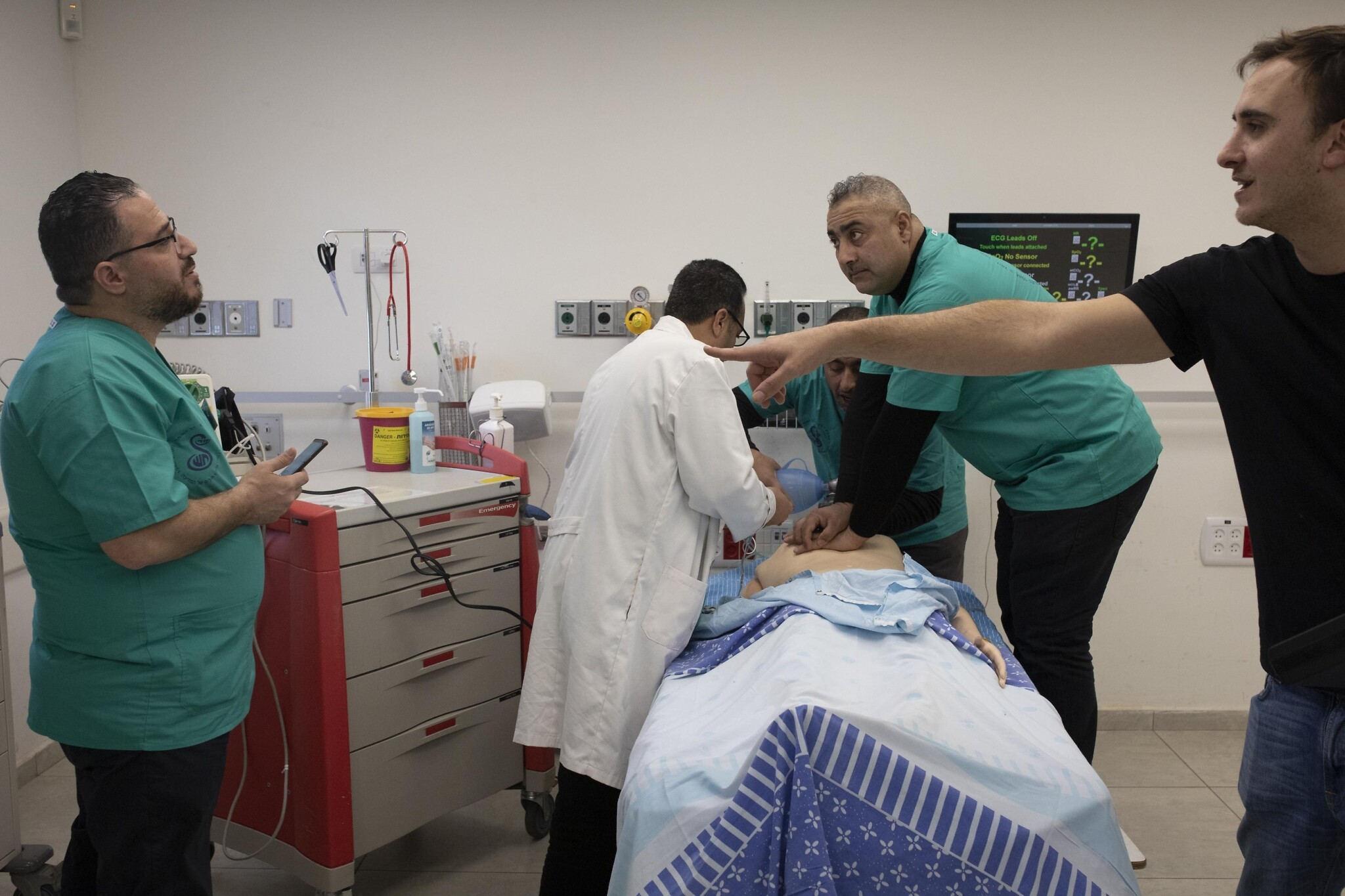 A group of Palestinian nurses from the West Bank and Gaza Strip taking part in a special four-day medical simulation course at the Sheba Medical Center at Tel Hashomer in Ramat Gan on January 1, 2020. (Oren Ziv/Activestills)
