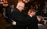 President Reuven Rivlin, left, with Zehava Shaul, mother of IDF soldier Oron Shaul whose remains are held in the Gaza Strip, seen during a meeting with global Jewish community leaders in Germany, January 29, 2020. (Courtesy: Shahar Azran)