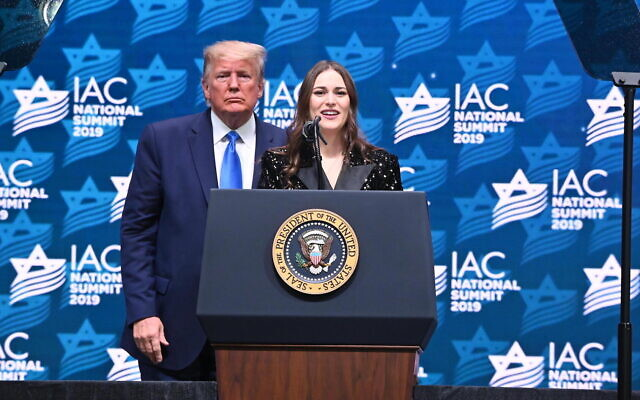 Adela Cojab on stage with US President Donald Trump during the 2019 Israeli-American Council National Summit in Florida, December 2019. (Noam Galai)