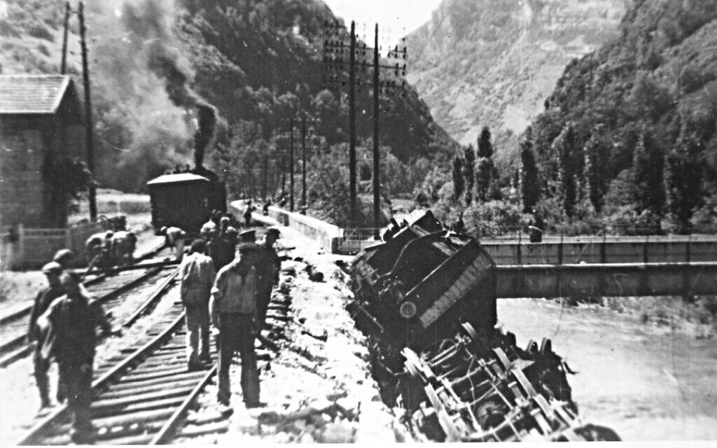 A derailed train lying on its side, the result of sabotage by Resistance fighters in France, June 9, 1944. The photo was taken by a German officer who would be killed by another Resistance ambush minutes later, and the film recovered and developed by the operatives. (Public domain)