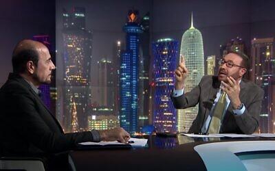 Al Jazeera presenter Faisal al-Qassem interviews former Iranian diplomat Amir Mousawi, January 7, 2019. (Screen capture: YouTube)