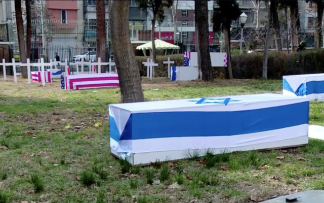 Fake US and Israeli coffins in a Tehran courtyard on January 22, 2019. (Channel 12 screenshot)