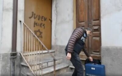 """""""Juden Hier,"""" German for """"Jews Here,"""" is seen spray-painted on the door of the home of the late Holocaust survivor Lidia Beccaria Rolfi, on January 24, 2019, in Mondovi, northern Italy. (Screen capture: Repubblica Torino)"""