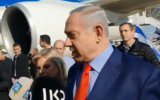 Prime Minister Benjamin Netanyahu speaks to reporters at Ben Gurion Airport before boarding a flight to Washington, Janaury 26, 2019. (Screen capture: Twitter)