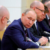 Russian President Vladimir Putin attends a meeting on drafting constitutional changes at the Novo-Ogaryovo residence outside Moscow, Russia, January 16, 2020. (Mikhail Klimentyev, Sputnik, Kremlin Pool Photo via AP)