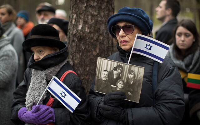 Mourners attend a symbolic 'March of the Living' at the Paneriai memorial, in memory of Lithuanian Jews killed by Nazis during World War II, in Vilnius, Lithuania, April 26, 2017. (AP Photo/Mindaugas Kulbis)