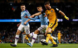 Port Vale's Tom Pope, right, during a soccer match in Manchester, England, January 4, 2020. (Martin Rickett/PA via AP)