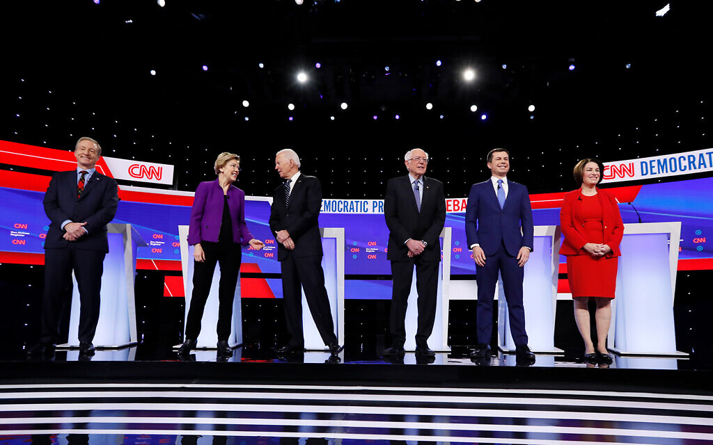 From left, Democratic presidential candidates Tom Steyer, Sen. Elizabeth Warren, D-Mass., former Vice President Joe Biden, Sen. Bernie Sanders, I-Vt., former South Bend Mayor Pete Buttigieg, and Sen. Amy Klobuchar, D-Minn., stand on stage, January 14, 2020, before a Democratic presidential primary debate in Des Moines, Iowa. (AP Photo/Charlie Neibergall)