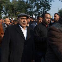 Iraqi acting Prime Minister Adel Abdel Mahdi takes part in the funeral of Iran's top general Qassem Soleimani in Baghdad, Iraq, January 4, 2020. (AP Photo/Nasser Nasser)