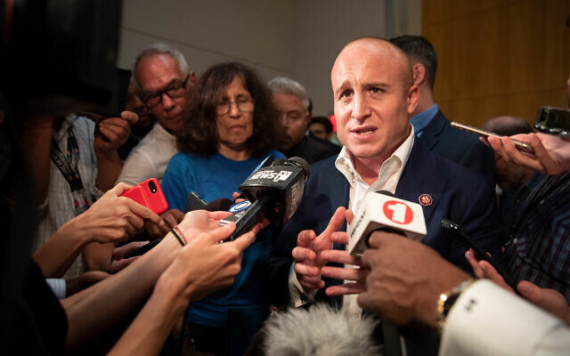 Max Rose speaks to reporters after a town hall meeting at the Joan and Alan Bernikow Jewish Community Center in the Staten Island borough of New York, October 2, 2019. (AP/Mary Altaffer)